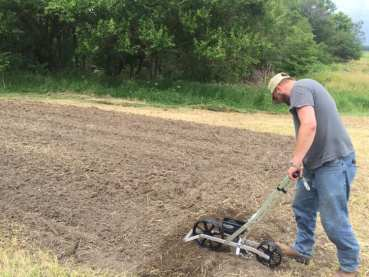 Using a new Precision Garden Seeder to plant the sorghum/broom corn