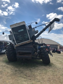 "This combine could ""shift"" so the combine head would slant with the hillside but the grain in the hopper would stay level - keeping it from spilling out if close to the top or at an extreme angle."
