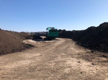 "This mulcher is one of several at Midwest Organics in one of the ""compost valleys"""