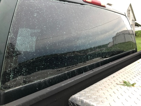The pressure from the storm changed so much (or built up so much) that the truck window shattered and bowed outward.