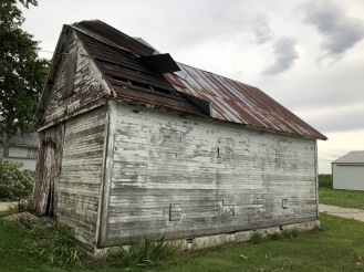 The tin got blown off pretty good and the door blown in, but at least this building survived! It's one of the last original buildings on the farm!